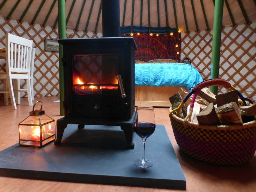 Yurt, glamping, fire, log burner, stove, cosy, warm, snug, wine. fairy lights, candles, wood, luxury, traditional, simple, nature, holiday, retreat, break, winter break