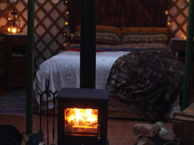 yurt, glamping, fire, log burner, stive, warm, cosy, snug, bed, fairy lights, fairylights, wood, basket, lanterns, candles, winter break, winter holiday, weekend break, unique retreat, winter glamping, magic, magical