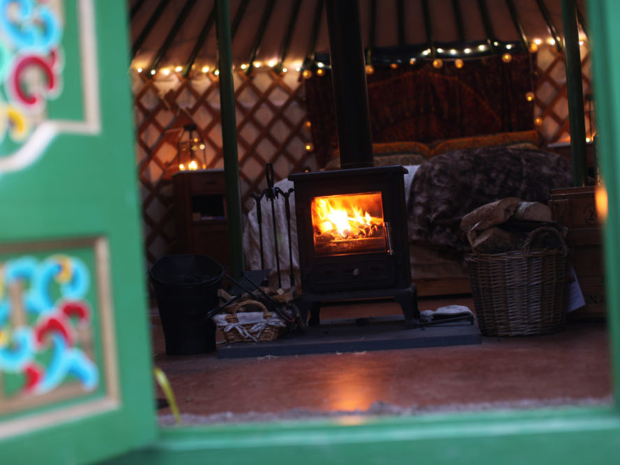 Yurt, glamping, yurt holiday, family holiday, pet friendly, child friendly, luxury, fire, log burner, fairy lights, cosy